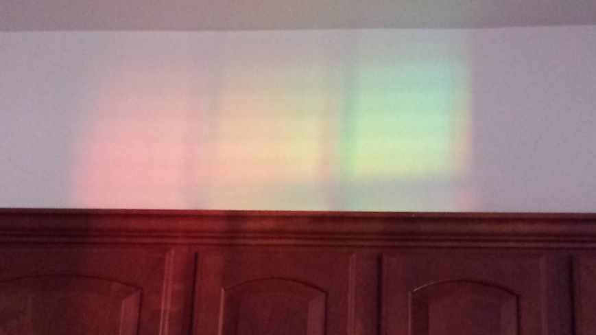 This rainbow appeared our last week in the old townhouse. The source was unexpected.