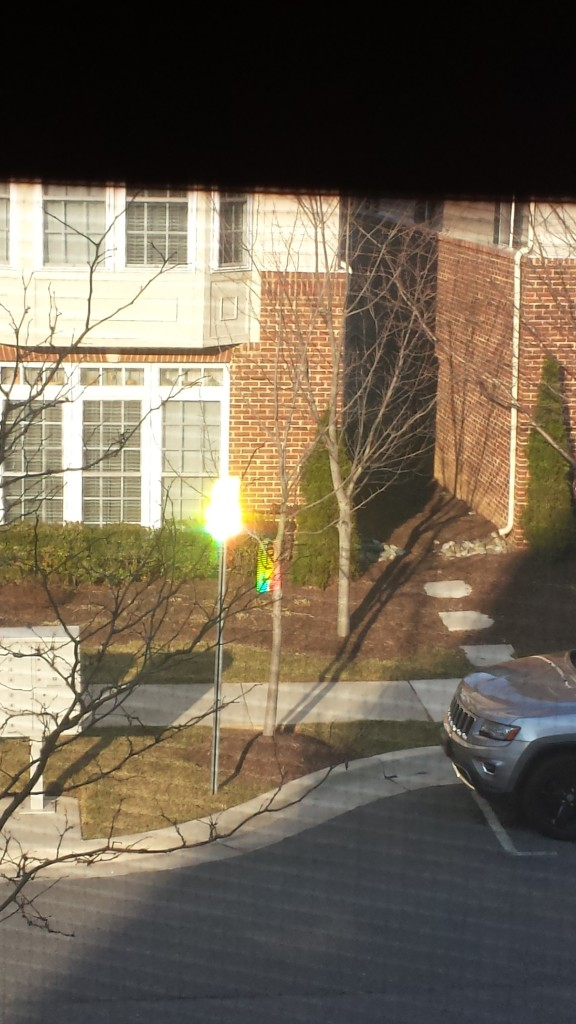 It was the sun reflecting off a parking sign.